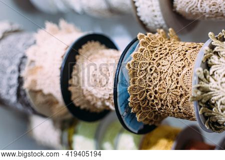 Skeins Of Lace Hang On A Shelf In A Craft And Craft Store.