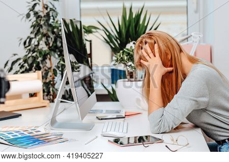 Frustrated Female Office Worker Despairs And Overworks At Table