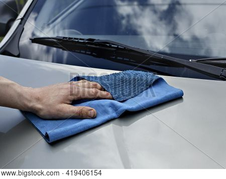 Car Detailing And Cleaning By Hand And Microfiber Towel. Polishing The Car Exterior With Car Shine P