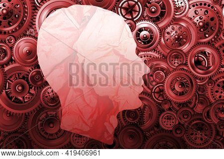 Technology Development And Training Concept. Silhouette Of A Man's Head From Crumpled Paper On A Bac