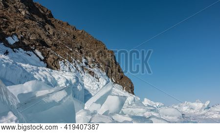 On The Surface Of The Frozen Lake There Are Blocks Of Ice Hummocks. The Ice Floes Are Covered With S