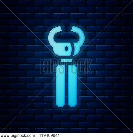 Glowing Neon Clippers For Grooming Pets Icon Isolated On Brick Wall Background. Pet Nail Clippers. V