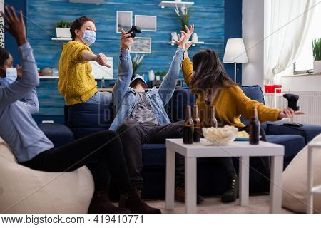 Man Losing Video Game Competiton Against Multi Ethnic Friends