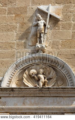 Sculptures Above The Entrance To The Cathedral In Gravina In Puglia. Italy
