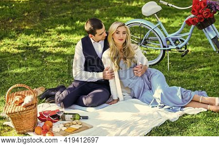 Man And Woman In Love. Couple In Love Enjoy Picnic Time. Spring Date. Playful Couple Having Picnic I