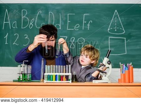 Teacher And Pupil Boy In Chemical Laboratory. Invent Medicines. Pharmaceutical Scientist. Science An