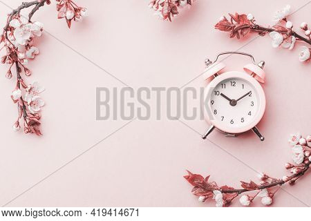 Spring Time Background. May Flowers And April Floral Nature With Alarm Clock On Pink. Branches Of Bl