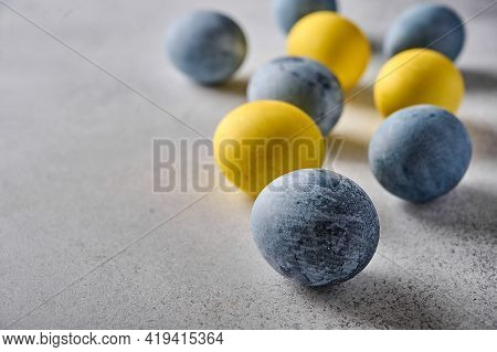 Homemade Easter Colored Yellow And Grey Marble Eggs. Close Up, Selective Focus