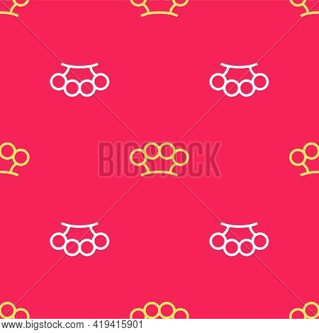 Yellow Brass Knuckles Icon Isolated Seamless Pattern On Red Background. Vector