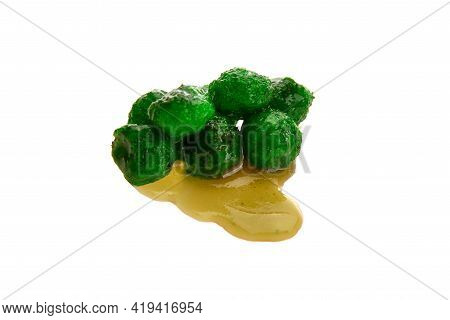 Close Up View Of Green Boilies In Dip, Fishing Baits For Carp Isolated On White Background