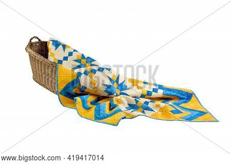 Patchwork Yellow-blue Quilt On A White Background. Patchwork Blanket. Handmade. Patchwork Quilt On A