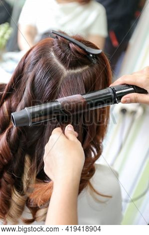 Woman\'s Hair Being Coloring Or Painted At The Hair Stylist Beauty Salon