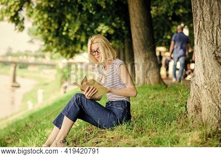 Literature For Summer Vacation. Summer Vacation. Student Smart Nerd Sit On Green Grass And Read Book