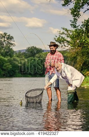 Family Traditions. Two Male Friends Fishing Together. Happy Fishermen. Good Profit. Fly Fish Hobby O