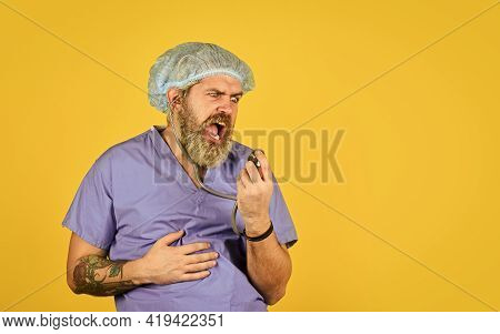 Healthcare And Treatment Concept. Copy Space. Healthy Lifestyle. Man Going Crazy Using Stethoscope.