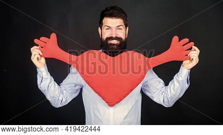 Man Bearded Hipster Hug Heart. Make Him Feel Loved Every Day. Celebrate Valentines Day. Guy With Bea