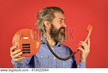 Ads Made Enticing. Vintage Communication Device. Businessman Talking On Vintage Phone In His Office.