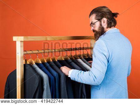 Well Groomed Man In Wedding Formalwear Has Beard Choose Jacket In Wardrobe, Designer