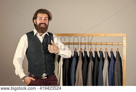 Stylish Business Man At Workspace. Fashion Design Studio. Male Fashion Designer. Individual Measures
