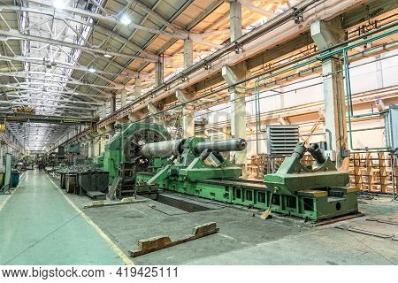 Large Industrial Workshop Factory Interior With Machines, Lathes And Steel Pipes For Processing Meta