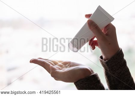 Disinfecting Hands. Taking Disinfection Alcohol Gel On Hands In White Light To Prevent Virus Epidemi
