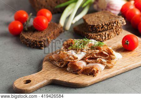 Ukrainian Lard, Pork Lard, Sprinkled With Fresh Chopped Herbs On A Wooden Board