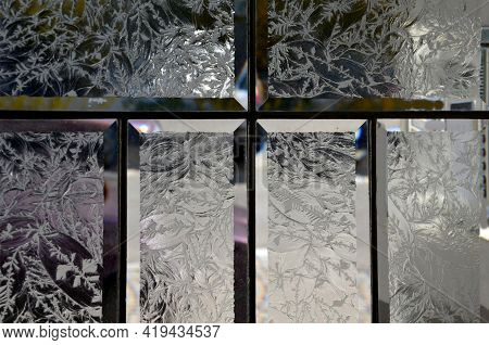 Cut Glass Panels Of Old Doors. The Edges Of The Glass Tables Are Smooth And The Center Is In The Pat