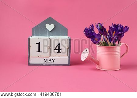 Calendar For May 14: A Cube With The Number 14, The Name Of The Month Of May In English,a Pink Water