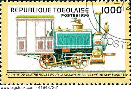 Togo - Circa 1996: A Stamp Printed In Togo Shows An Old Four-wheel Locomotive Designed For The New Y