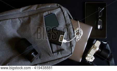 Laptop, Smartphone, Power Bank, Mirrorless Camera And Other Modern Gadgets Next To A Trendy Gray Cit