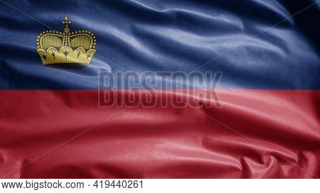 Liechtensteiner Flag Waving In The Wind. Liechtenstein Banner Blowing Soft Silk.
