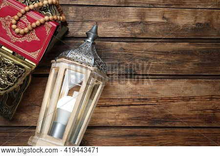 Arabic Lantern, Quran And Misbaha On Wooden Table, Flat Lay. Space For Text