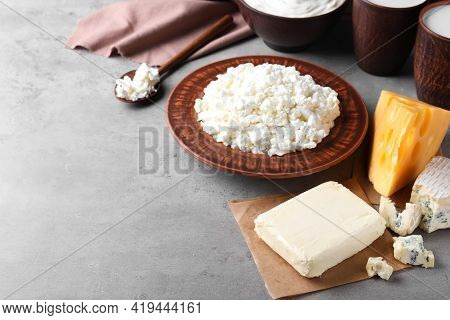Clay Dishware With Fresh Dairy Products On Grey Table, Space For Text