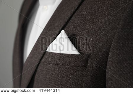 Man With Handkerchief In Breast Pocket Of His Suit On Light Grey Background, Closeup