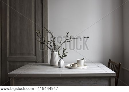 Minimalistic Scandinavian Style. Half-open Branches Of An Apple Tree In A White Fluted Vase. A Small