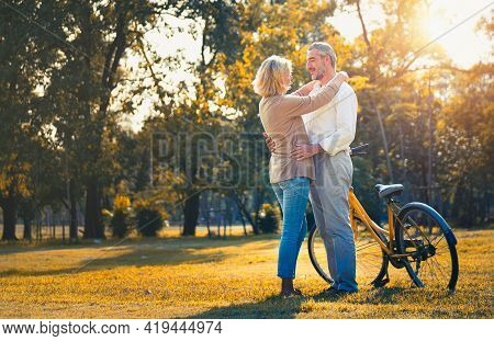 Couple Elderly Relaxation Or Romantic Time In The Park Together In Autumn Season. Happy Retirement L