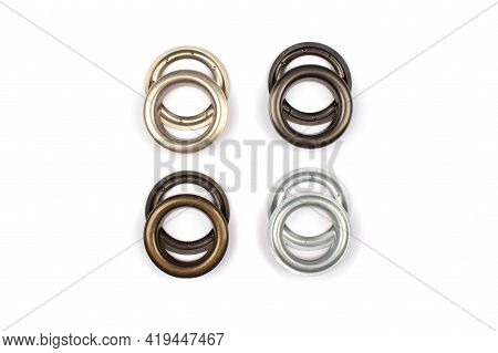Different Brass Multicoloured Metal Eyelets Or Rivets - Curtains Rings For Fastening Fabric To The C