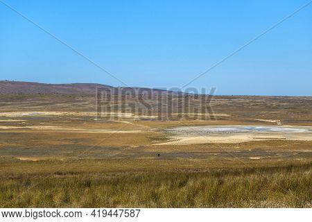 Panorama Of Bulganak Field Of Mud Volcanoes Near By Kerch, Crimea. Right Side Is Mud Sopka (or Hill)