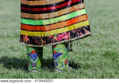 MASHANTUCKET RESERVATION, CT, USA-AUGUST 25, 2018:  Dancer close up  from SchemitzunThe 27th Annual Feast of Green Corn and Dance Powwow