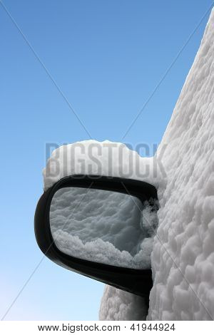 Car mirror in winter isolated