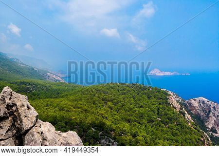 Blue Bay Among Rocky Mountains On A Summer Day