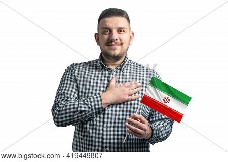 White Guy Holding A Flag Of Iran And Holds His Hand On His Heart Isolated On A White Background With
