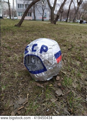 The Helmet From The Spacesuit Made With His Own Hands From A Children's Suit Is Lying On The Lawn. T