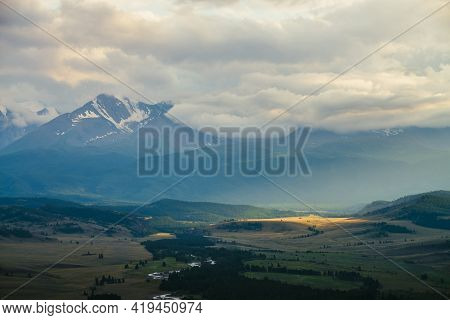 Scenic Landscape With Vast Plateau With Mountain River And Forest In Sunlight On Background Of Snowy