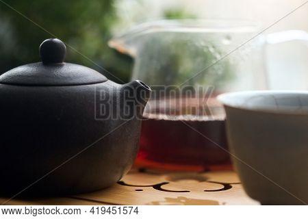 Tea Ceremony Gong Fu Cha. Selective Focus. Handmade Purple Yixing Zisha Clay Chinese Teapot With Shu
