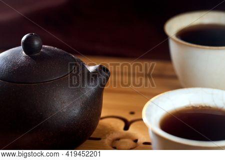 Tea Ceremony Gong Fu Cha. Handmade Purple Yixing Zisha Clay Chinese Teapot With Shu Pu Erh And Two C