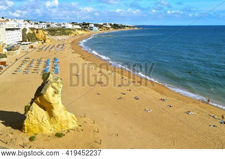 Albufeira, Algarve, Portugal - October 26, 2015 : Tourists Enjoying The Sun On Albufeira Beach In Po