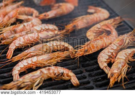 Close Up - Process Of Cooking Fresh Red Langoustine Shrimps, Prawns On Grill At Summer Local Food Ma