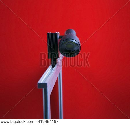 Studio Spot Lighting On A Red Background