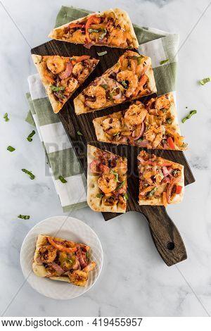 Applewood Smokey Bbq Shrimp Flatbread Pizza On A Cutting Board Ready For Eating.